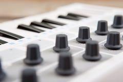 Close up of MIDI controller volume fader, knob and keys royalty free stock photos