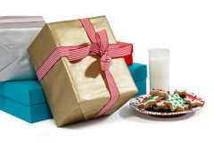Close-up of milk and sweet food in plate with wrapped gift Royalty Free Stock Photography