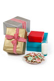 Close-up of milk and sweet food in plate with wrapped gift Royalty Free Stock Photos