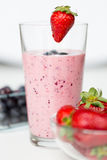 Close up of milkshake decorated with strawberry Royalty Free Stock Photos
