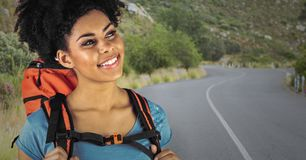 Close up of millennial backpacker against road Royalty Free Stock Photos