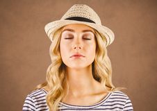 Close up of millennial woman eyes closed against brown grunge background. Digital composite of Close up of millennial woman eyes closed against brown grunge stock images