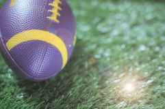 Close up of mini American football on the green grass Stock Photos