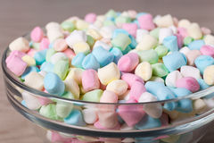Close up of mini marshmallows in glass bowl Stock Photos