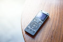 Close up of mini recorder on wooden table. Equipment record sound stock photo