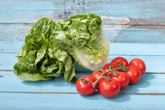 Close up of mini romaine lettuce and vine tomatoes Royalty Free Stock Photography