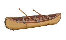 Close-up of a miniature birch bark canoe isolated. Hand made miniature birch bark canoe with two paddles.  Isolated on white Stock Photography