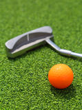 Close-up of miniature golf hole with bat and ball Royalty Free Stock Images