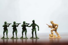 Close-up of miniature a group of plastic toys soldiers at war. stock images