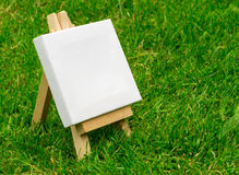 Close up of a Miniature Model Artists Easel. Close up of a wooden miniature model artists easel on grass with copyspace area and design space Stock Images