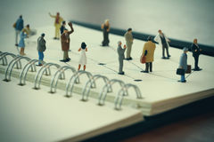 Close up of miniature people with social network diagram Royalty Free Stock Images