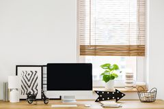 Close-up on a minimalist, white workspace interior by a window w royalty free stock photos