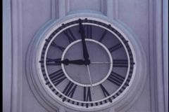 Close-up of minute hand on wall clock moving to 9 o'clock stock video footage