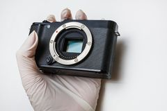Close-up of mirrorless digital APS-C dirty camera matrix sensor cleaning and maintenance with swab, photographer cleaning royalty free stock image