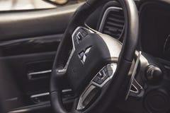 Close up on Mitsubishi Outlander steering wheel. Wroclaw, Poland, May 28, 2016: Close up on Mitsubishi Outlander steering wheel on Motoshow on May 28, 2016 in Royalty Free Stock Photo