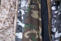 Close up on mixed camo clothing of army stock photo