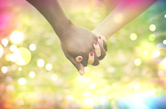 Close up on a mixed race couple holding hands Stock Photos