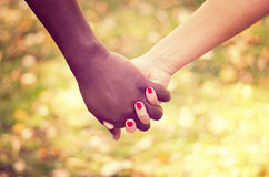Close up on a mixed race couple holding hands Stock Images