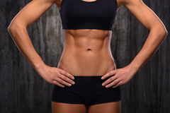 Close up of mixed race female slim belly Royalty Free Stock Images