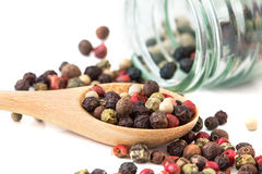 Close up mixed type of the peppercorns in wooden spoon Stock Photos