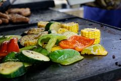 Close up of mixed vegetables grilled on outdoor grill. Stock Images
