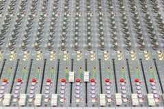Close up Mixing Console of a big HiFi system, The audio equipment and control panel. Of digital studio mixer stock photo