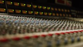Close-up of the Mixing console. Focus on the mixing console. Close-up of switches stock video