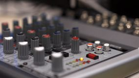 Close-up of mixing console. Stock. Close up multi color buttons of sound mixer console, shallow depth of field DOF stock image