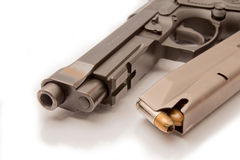 Close-up on 9mm ammo with a handgun. Stock Photo