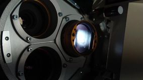 Close up of a 35mm cinema projector in a movie theater