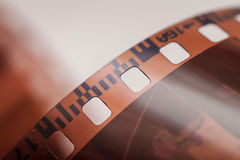Close-up of 35 mm photographic film. At the blurred background Royalty Free Stock Images