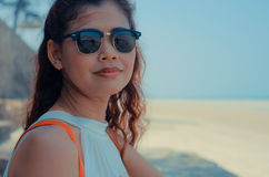 Close up of model on sunlit Thailand beach. royalty free stock photo