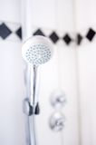 Close up of modern bathroom shower head at hotel Stock Image