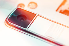 Close-up of modern camera in white smartphone. Image with red flare Stock Photo