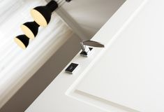 Close-up of modern chrome door handle. The elements of the beautiful interior of the apartment Royalty Free Stock Image