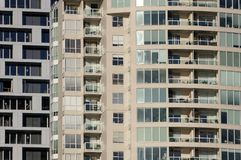 Densely packed condominiums stock photos