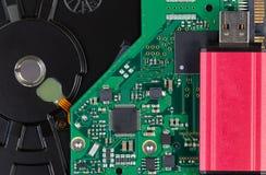 Close up of modern data backup thumb drive and external IDE hard Stock Photos