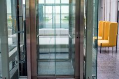 Lift with transparent glass doors in modern building. Close up of modern elevator with transparent doors in business building royalty free stock photos