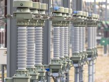 Modern isolators on power substation. Close up of modern  isolators on High voltage electricity transformation substation Royalty Free Stock Photos