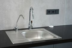 Modern kitchen. Faucet and sink. Close up on Modern kitchen. Faucet and sink royalty free stock photo