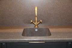 Monochrome kitchen detail. Close up of modern kitchen faucet and sink. Close up of modern kitchen faucet and sink. Faucet stock photos