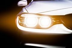 Close-up modern luxury car headlights. Exterior detail Stock Photos