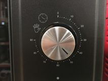 Close up of modern microwave control panel, knob and modes royalty free stock photos