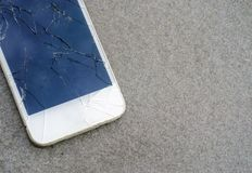 Close up modern mobile phone with broken screen on asphalt road. Close up of broken mobile phone drop on cement floor with copy space, Smartphone with broken stock images