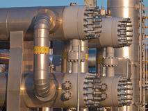 Close up of a modern natural gas processing plant. During sunset Stock Photos