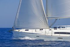 Close-up of a sailing yacht in action. Close-up of a modern sailing yacht in action. Blue waters of the Aegean sea, Greece stock photo