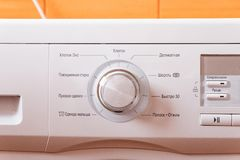 Close up of a modern washing machine control panel, with button timer and options royalty free stock photo