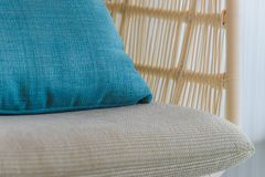 Close up modern wicker chair with cushion and comfort pillow in room. Near by the window. Close up modern wicker chair with cushion and comfort pillow. Near by stock photos