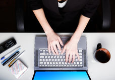 Close-up modern workplace. Top view. Woman working at laptop. Royalty Free Stock Images