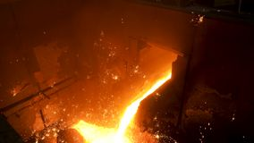 Close up for molten metal poured from ladle for casting at the foundry. Stock footage. Smelting of metal casting stock video footage